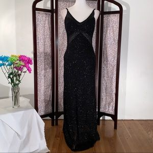 Scala black spaghetti strapped evening gown.
